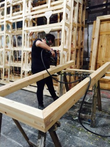 Helen making door frames